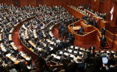 Upper house members vote during the full assembly where the House of Representatives pass the Anti Terrorism Special Measure bill at the Parliament...