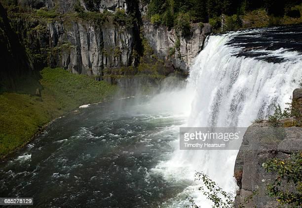 Upper Mesa Falls cascades into river below