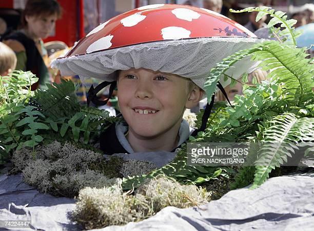 Swedish nineyearold boy Joel Lundberg is dressed as a mushroom as children parade as flowers fruits and vegetables in Uppsala 23 May 2007 on the...