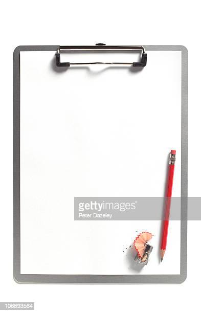 Upright clipboard with red pencil with copy space
