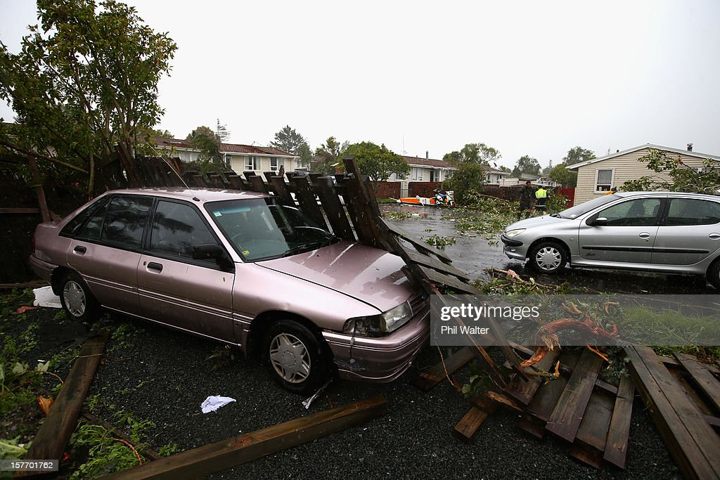 Uprooted trees and storm debri are scattered around the Auckland suburb of Hobsonville in the aftermath of a tornado that struck on December 6, 2012 in Auckland, New Zealand. Three people have been confirmed dead and torrential rain has caused surface flooding across Auckland.