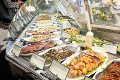 High end deli case with freshly prepared ready to serve meals
