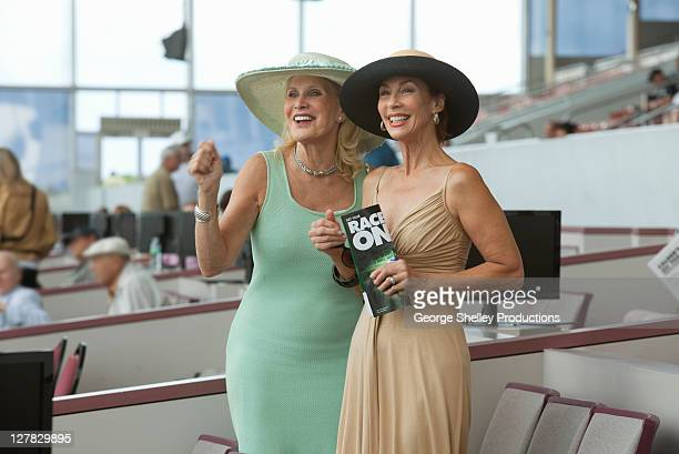 Upscale senior women enjoying a horse race