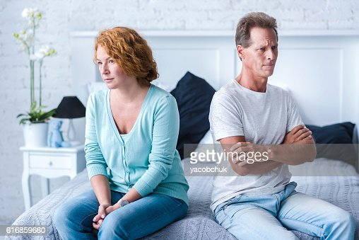 Upset aged couple after a quarrel : Stock Photo