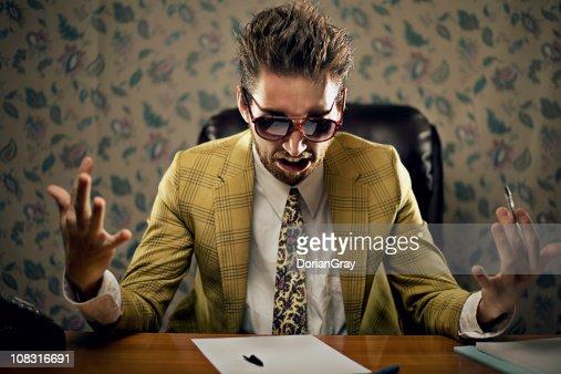 Upset businessman wearing yellow suit : Bildbanksbilder