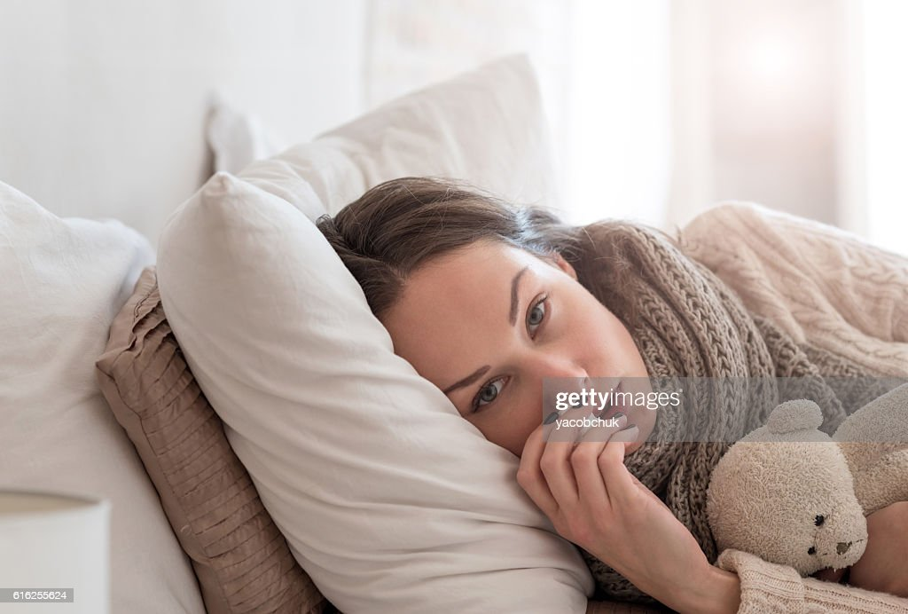 Upset exhausted woman suffering from an illness : Stock Photo