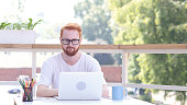 Upset Man after Failure of Project, Loss, Sitting in Outdoor Office, Red Hairs