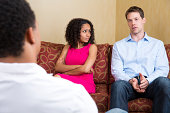 Upset mixed-race couple at the marriage counselor