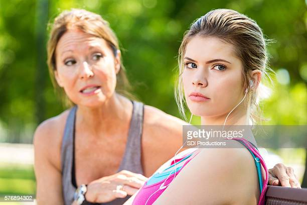 Upset teenage daughter ignoring her concerned mother during an argument