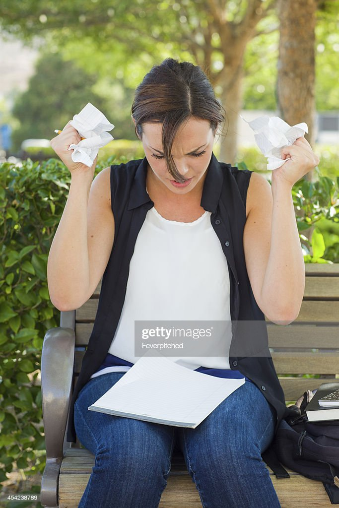 Upset Young Woman with Pencil and Crumpled Paper in Hands : Stock Photo
