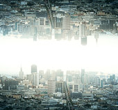 Abstract reflected upside down city on light backgrounf