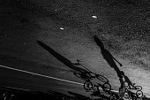 Upside Down Image Of Children Riding Bicycle On Road