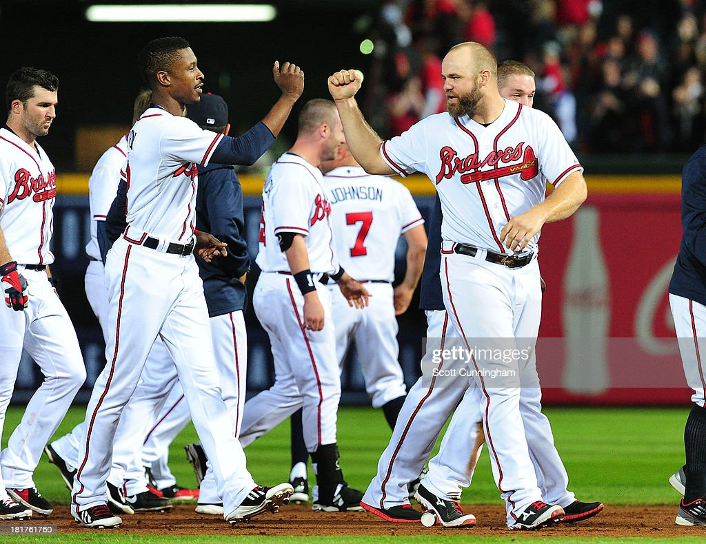 B. J. Upton #2 and <a gi-track='captionPersonalityLinkClicked' href=/galleries/search?phrase=Evan+Gattis&family=editorial&specificpeople=8977937 ng-click='$event.stopPropagation()'>Evan Gattis</a> #24 of the Atlanta Braves celebrate after the game against the Milwaukee Brewers at Turner Field on September 24, 2013 in Atlanta, Georgia.