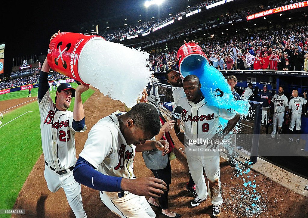 B. J. Upton #2 and his brother <a gi-track='captionPersonalityLinkClicked' href=/galleries/search?phrase=Justin+Upton&family=editorial&specificpeople=846265 ng-click='$event.stopPropagation()'>Justin Upton</a> #8 of the Atlanta Braves are dunked with Gatorade after the game against the Chicago Cubs at Turner Field on April 6, 2013 in Atlanta, Georgia.