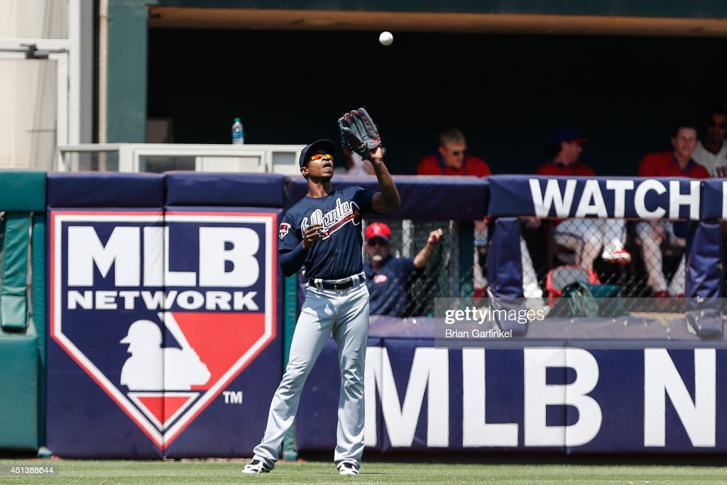 <a gi-track='captionPersonalityLinkClicked' href=/galleries/search?phrase=B.J.+Upton&family=editorial&specificpeople=810704 ng-click='$event.stopPropagation()'>B.J. Upton</a> #2 of the Atlanta Braves catches a long fly ball in the second inning of the first game of a doubleheader against the Philadelphia Phillies at Citizens Bank Park on June 28, 2014 in Philadelphia, Pennsylvania.
