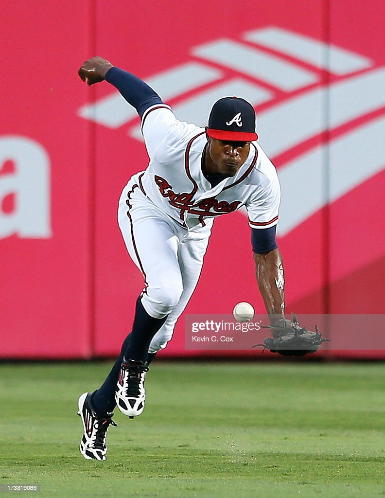 <a gi-track='captionPersonalityLinkClicked' href=/galleries/search?phrase=B.J.+Upton&family=editorial&specificpeople=810704 ng-click='$event.stopPropagation()'>B.J. Upton</a> #2 of the Atlanta Braves fails to come up with this line drive by Todd Frazier #21 of the Cincinnati Reds in the fourth inning at Turner Field on July 11, 2013 in Atlanta, Georgia.