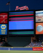 J Upton of the Atlanta Braves looks back as a malfunction with the jumbotron occurs during the fifth inning against the Milwaukee Brewers at Turner...