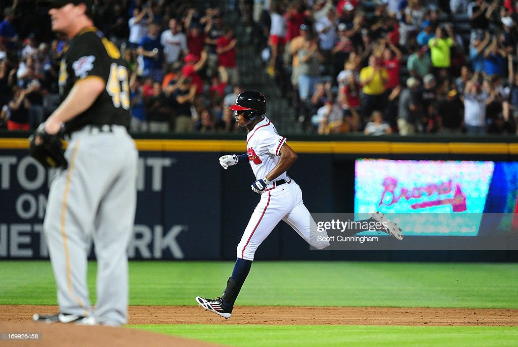 B. J. Upton #2 of the Atlanta Braves rounds the bases after hitting a sixth inning home run against Ryan Reid #43 of the Pittsburgh Pirates at Turner Field on June 4, 2013 in Atlanta, Georgia.