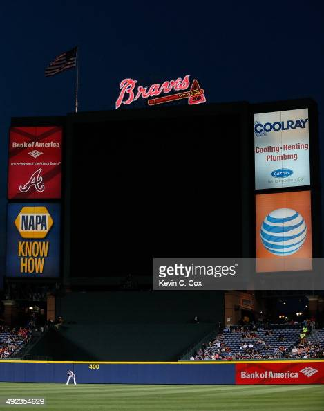 J Upton of the Atlanta Braves stands in the outfield as the jumbotron is powered down during a malfunction in the fifth inning against the Milwaukee...