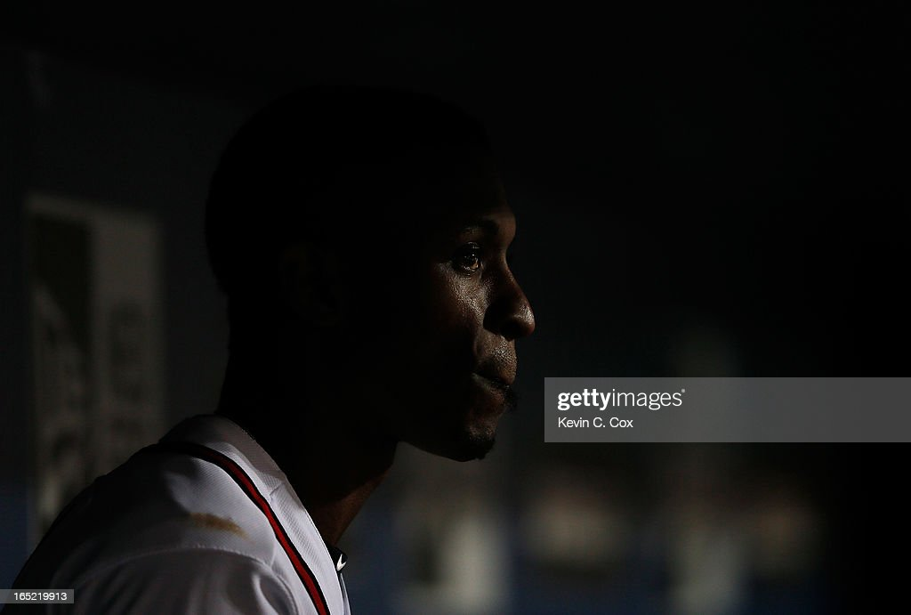 <a gi-track='captionPersonalityLinkClicked' href=/galleries/search?phrase=B.J.+Upton&family=editorial&specificpeople=810704 ng-click='$event.stopPropagation()'>B.J. Upton</a> #2 of the Atlanta Braves waits in the dugout in the eighth inning against the Philadelphia Phillies during Opening Day at Turner Field on April 1, 2013 in Atlanta, Georgia.