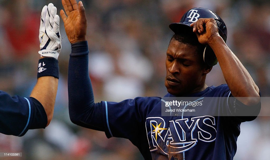 <a gi-track='captionPersonalityLinkClicked' href=/galleries/search?phrase=B.J.+Upton&family=editorial&specificpeople=810704 ng-click='$event.stopPropagation()'>B.J. Upton</a> #2 of the Tampa Bay Rays is congratulated by a teammate after scoring against the Cleveland Indians during the game on May 11, 2011 at Progressive Field in Cleveland, Ohio.