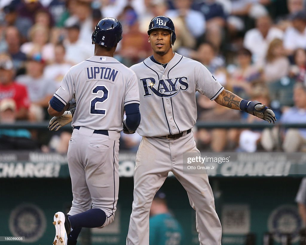 <a gi-track='captionPersonalityLinkClicked' href=/galleries/search?phrase=B.J.+Upton&family=editorial&specificpeople=810704 ng-click='$event.stopPropagation()'>B.J. Upton</a> #2 of the Tampa Bay Rays is congratulated by <a gi-track='captionPersonalityLinkClicked' href=/galleries/search?phrase=Desmond+Jennings&family=editorial&specificpeople=5974085 ng-click='$event.stopPropagation()'>Desmond Jennings</a> #8 after hitting a two-run homer against the Seattle Mariners at Safeco Field on August 13, 2012 in Seattle, Washington.
