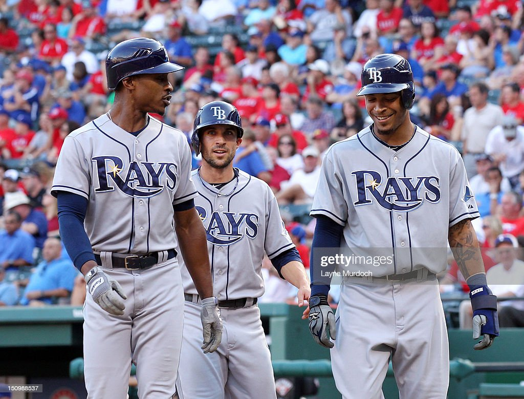 B.J. Upton #2 of the Tampa Bay Rays is congratulated by teammates Sam Fuld (C) and Desmond Jennings after hitting a three-run homer against the Texas Rangers on August 29, 2012 at the Rangers Ballpark in Arlington in Arlington, Texas.