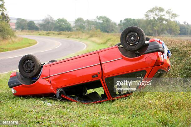 Upturned car on the side of the road