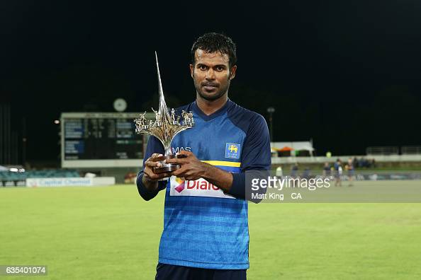 Upul Tharanga captain of Sri Lanka poses with the winners trophy after the T20 warm up match between the Australian PM's XI and Sri Lanka at Manuka...