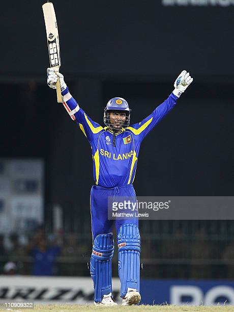 Upul Tharanga of Sri Lanka celebrates his century during the 2011 ICC World Cup Quarter Final match between Sri Lanka and England at R Premadasa...