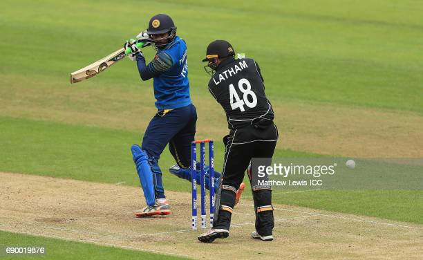 Upul Tharanga of Sri Lanka edges the ball past Tom Latham of New Zealand during the ICC Champions Trophy Warmup match between New Zealand and Sri...