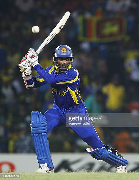Upul Tharanga of Sri Lanka hits the ball towards the boundary during the 2011 ICC World Cup Quarter Final match between Sri Lanka and England at R...