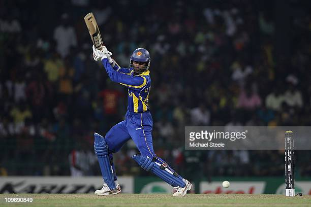 Upul Tharanga of Sri Lanka hits to the offside during the Kenya v Sri Lanka 2011 ICC World Cup Group A match at the R Premadasa Stadium on March 1...