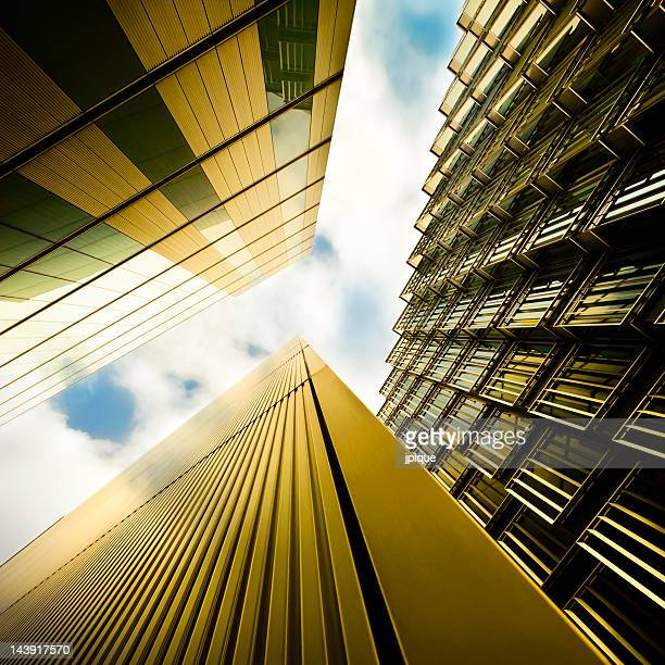 Upward view of futuristic financial buildings and the sky