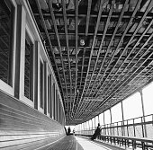 Upward view showing life jackets stashed in the ceiling of the Staten Island ferry with three passengers visible in the distance New York New York...