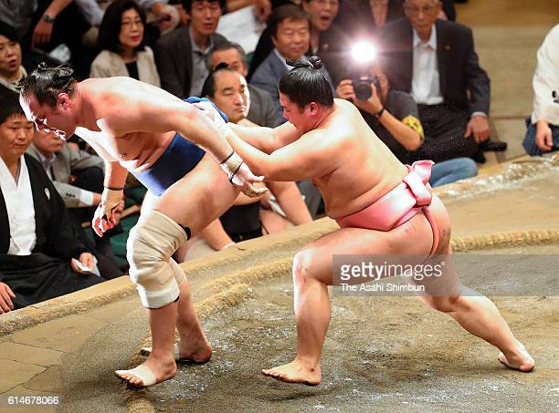 Ura sends Russian wrestler Amuuru out of the ring to win in the Juryo rank during day fourteen of the Grand Sumo Autumn Tournament at Ryogoku...