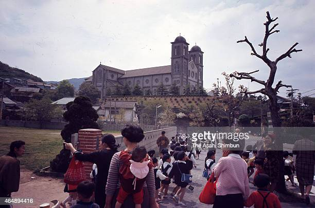 Urakami Cathedral and kindergarten children are seen circa July 1968 in Nagasaki Japan The cathedral was rebuilt in 1959 after destroyed by the...
