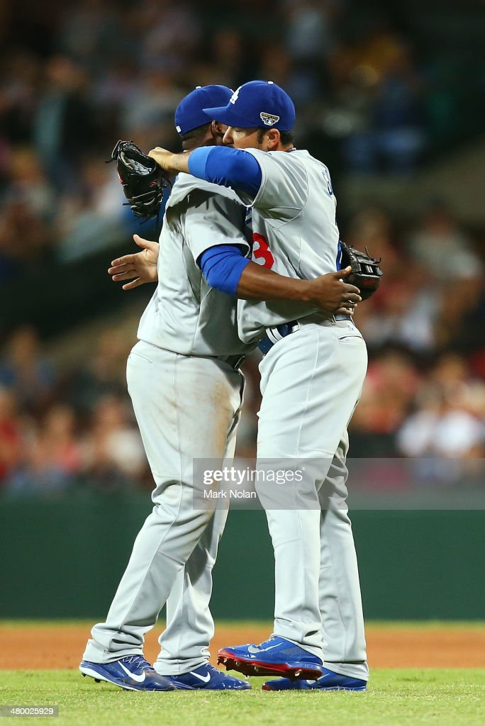 Uran Uribe and Adrian Gonzalez embrace after winning the opening match of the MLB season between the Los Angeles Dodgers and the Arizona Diamondbacks at Sydney Cricket Ground on March 22, 2014 in Sydney, Australia.