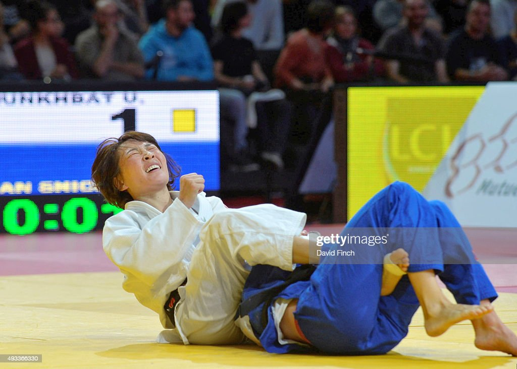 Urantsetseg Munkhbat of Mongolia (white) reacts to her victory over <a gi-track='captionPersonalityLinkClicked' href=/galleries/search?phrase=Charline+Van+Snick&family=editorial&specificpeople=6586925 ng-click='$event.stopPropagation()'>Charline Van Snick</a> of Belgium to win the u48kg (extra-lightweight) gold medal during the 2015 Paris Grand Slam at the Bercy-Paris Arena on on October 18, 2015 in Bercy, Paris, France.