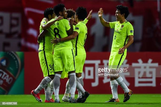 Urawa' players celebrate the goal during the AFC Champions League semifinal football match between Shanghai SIPG FC and Urawa Red Diamonds in...