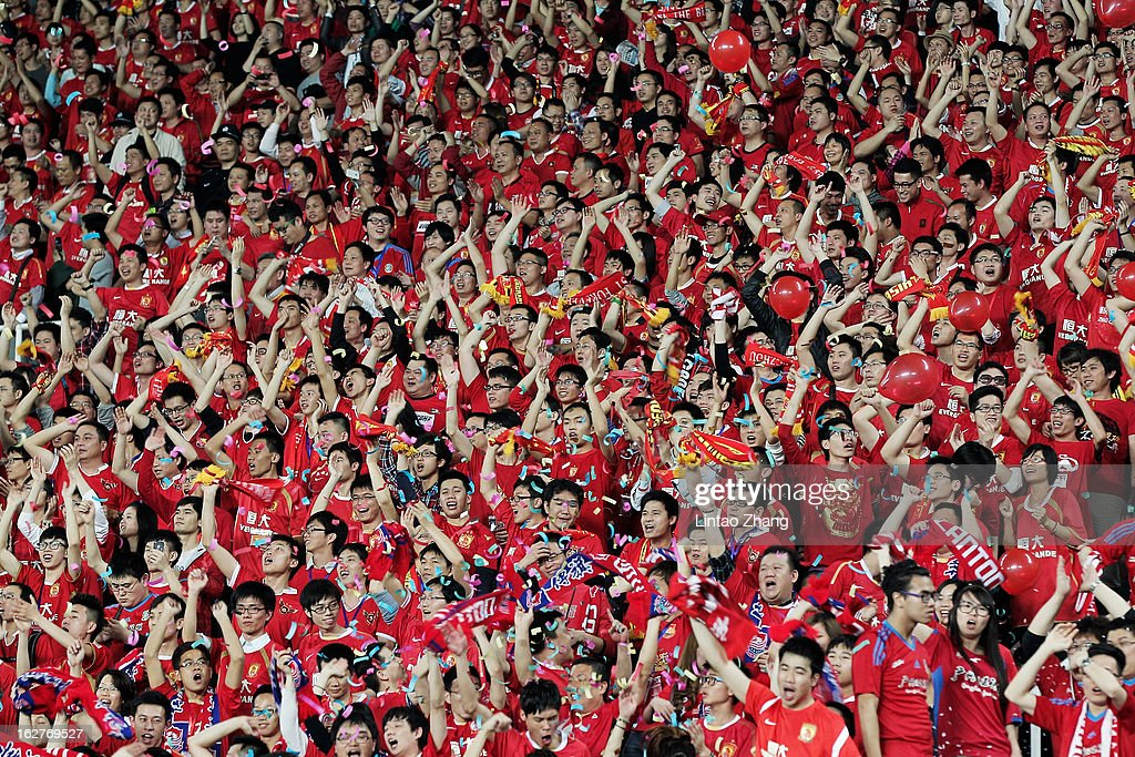 Urawa Red Diamonds fans react during the AFC Champions League Group F match between Guangzhou Evergrande and Urawa Red Diamonds at Tianhe Stadium on February 26, 2013 in Guangzhou, China.