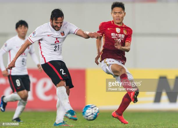 Urawa Red Diamonds forward Zlatan Ljubijankic fights for the ball with Guangzhou Evergrande midfielder Wang Shangyuan during the AFC Champions League...