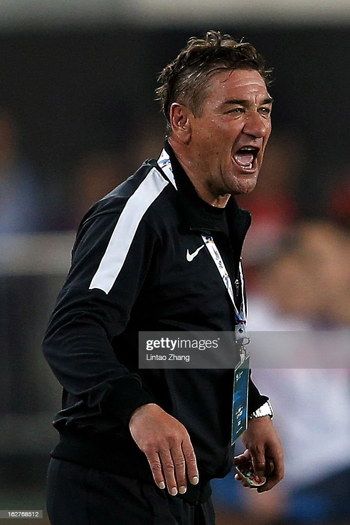 Urawa Red Diamonds head coach Mihailo Petrovic reacts during the AFC Champions League Group F match between Guangzhou Evergrande and Urawa Red Diamonds at Tianhe Stadium on February 26, 2013 in Guangzhou, China.