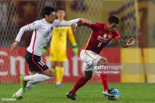 Urawa Red Diamonds midfielder Aoki Takuya fights for the ball with Guangzhou Evergrande midfielder Bezerra Maciel Junior during the AFC Champions...