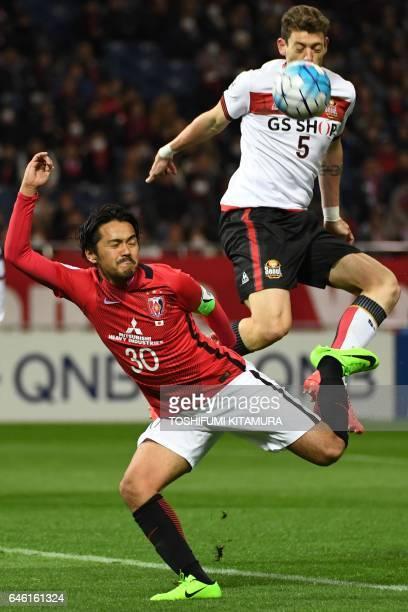 Urawa Red Diamonds' midfielder Shinzo Koroki vies for the ball with FC Seoul's midfielder Ibanez Osmar Barba during the AFC Champions League group F...
