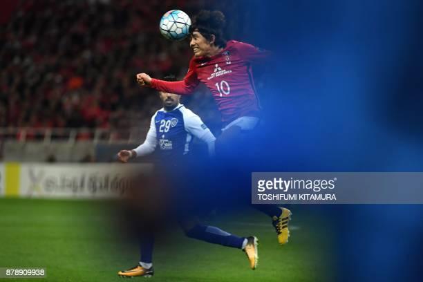 Urawa Red Diamonds' midfielder Yosuke Kashiwagi heads the ball past Al Hilal's midfielder Salem alDawsari during the second leg of the AFC Champions...