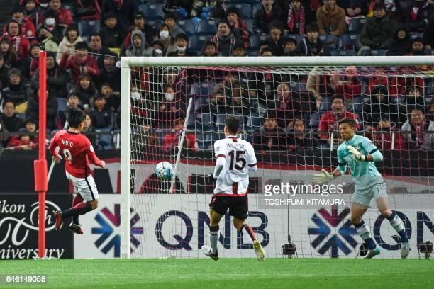 Urawa Red Diamonds' midfielder Yuki Muto scores a goal during the AFC Champions League group F football match between Japan's Urawa Red Diamonds and...