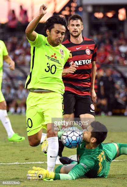 Urawa Red Diamonds player Kohrogi Shinzoh attempts to steer the ball past Western Sydney Wanderers goalkeeper Vedran Janjetovic as Brendan Hamill...
