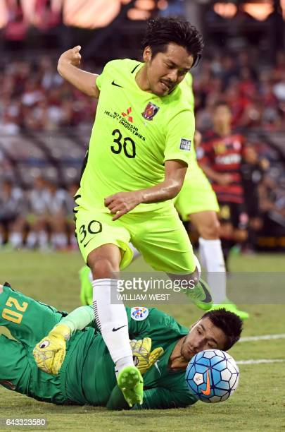 Urawa Red Diamonds player Kohrogi Shinzoh attempts to steer the ball past Western Sydney Wanderers goalkeeper Vedran Janjetovic during their AFC...