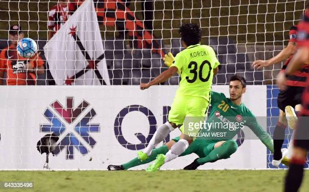 Urawa Red Diamonds player Kohrogi Shinzoh scores a goal past Western Sydney Wanderers goalkeeper Vedran Janjetovic during their AFC Champions League...
